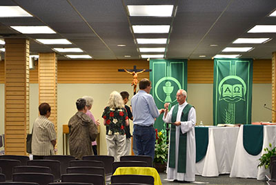While renovations continued on the chapel, a makeshift chapel was constructed for daily Mass in Chaminade Hall. The space was a former bookstore. (CT Photo/John Stegeman)