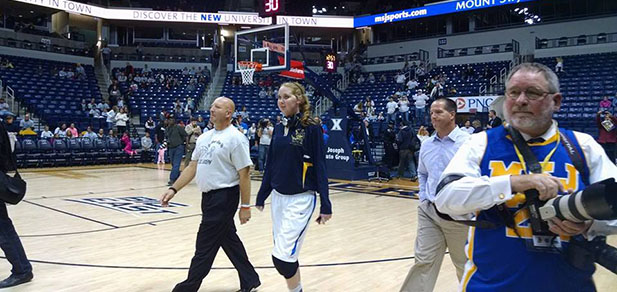 Lauren Hill, center, walks onto the floor of Xavier University's Cintas Center on Nov. 2, 2014 for her first collegiate game. (Courtesy Photo/The Cure Starts Now)