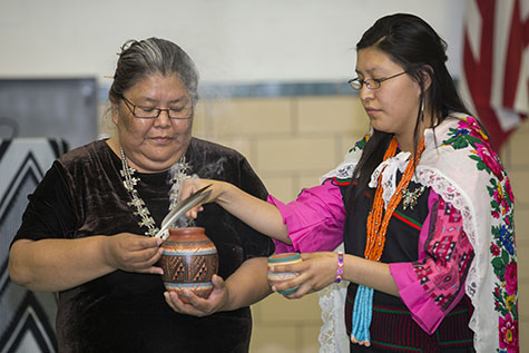 Star, Acoma, and Sadie, Navajo, bless the room before a Navajo ceremony while their group was visiting its Cincinnati twinning partner, Sts. Peter and Paul in Reading. (CT Photo/Colleen Kelly)