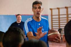 Villanova University Coach Jay Wright gives pointers to Arab and Israeli youth during a July 30 basketball clinic sponsored by PeacePlayers International in Jerusalem. The clinic was followed by a game with Arab, Israeli and American youth participating. (CNS photo/Mary Knight)