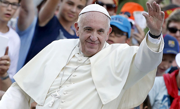 Pope Francis waves as he arrives to attend an audience with some 9,000 altar servers in St. Peter's Square at the Vatican Aug. 4. (CNS photo/Giampiero Sposito, Reuters)