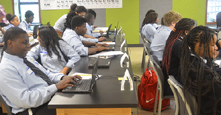 Freshmen students at DePaul Cristo Rey High School in Cincinnati participates in training this week to familiarize themselves with the technology they will use during the coming school year. (Courtesy Photo/De Paul Cristo Rey)
