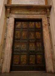 The Holy Door is pictured in St. Peter's Basilica at the Vatican March 13. Drawing on the experience of the public exposition of the Shroud of Turin, Vatican officials are adopting a reservation system for pilgrims who want to cross the threshold of the Holy Door during the Year of Mercy. (CNS photo/Paul Haring)