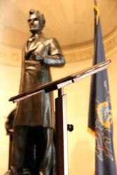 The lectern that President Abraham Lincoln used to deliver the Gettysburg Address almost 152 years ago is seen Aug. 7 at the Union League of Philadelphia in front of a statue of Lincoln. Pope Francis will use same lectern when he speaks at Independence Hall Sept. 26 during his two-day visit to Philadelphia this fall. (CNS photo/Sarah Webb, CatholicPhilly.com)