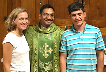 Father Earl Fernandes, center, with colleagues Simona Ferioli, MD, left, and Marco Caggioni, PhD. (Courtesy Photo/Athenaeum of Ohio)