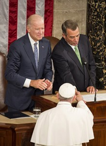 Pope Francis shakes hands with U.S. Speaker of the House John Boehner as U.S. Vice President Joe Biden looks on during a joint meeting of Congress on Capitol Hill Sept. 24 in Washington.  (CNS photo/Joshua Roberts)