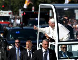 Pope Francis gives a thumbs up to the crowd as he rides down Constitution Avenue in his popemobile in Washington Sept. 23, day two of his first visit to the United States. (CNS photo/Gary Cameron, Reuters)