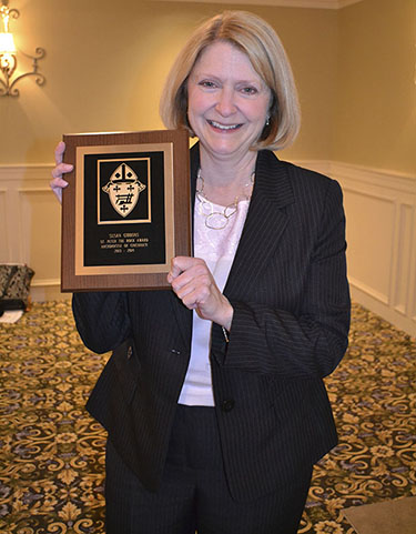 Susie Gibbons won the St. Peter the Rock Award, which is given to a member of the Catholic Schools Office who personifies excellence, hard work and a genuine sense of Catholic ministry, at the 2014 Archdiocesan Principal Awards lunch. (CT Photo/John Stegeman)