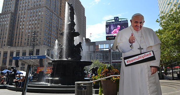 A cardboard cutout of Pope Francis is seen on Fountain Square Sept. 18. On Sept. 24, the Holy Father's speech to congress will air live on the Fountain Square big screen. (CT Photo/John Stegeman)