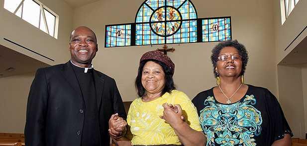 Father Francis Tandoh, pastor of St. Benedict the Moor, with parishioners Rita Ellicott and Juanita Newell. (Courtesy Photo)
