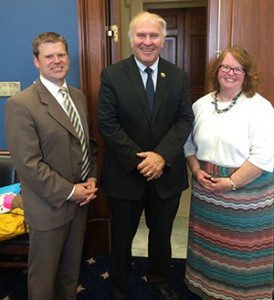 Tony Stieritz, director of the Archdiocese of Cincinnati Social Action Office, left, and Pam Long Regional Director for the Social Action Office, right, pose for a photo with Congressman Steve Chabot. (Courtesy Photo)