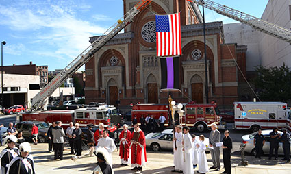 Father Steve Angi blessed emergency vehicles at the 2014 Blue Mass at the Cathedral of St. Peter in Chains. (CT Photo/John Stegeman)