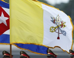 An honor guard carries the Cuban and Vatican flags during the arrival ceremony for Pope Francis at Jose Marti International Airport in Havana Sept. 19. (CNS photo/Paul Haring)