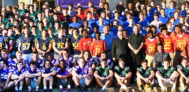 Catholic high school football teams from the southern parts of the Archdiocese of Cincinnati pose for a group photo with Archbishop of Cincinnati Dennis M. Schnurr after the SportsLeader Rosary Rally earlier this summer at the Athenaeum. Week two of the high school football season starts tonight. (CT Photo/John Stegeman)