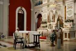 Pope Francis prays near the statue of Our Lady of Charity, patroness of Cuba, in the Minor Basilica of the Shrine of Our Lady of Charity in El Cobre, Cuba, Sept. 21. (CNS photo/Paul Haring)