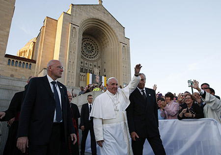 Pope Francis waves as he leaves the Basilica of the National Shrine of the Immaculate Conception after celebrating Mass and the canonization of Junipero Serra Sept. 23 in Washington. (CNS photo/Paul Haring)