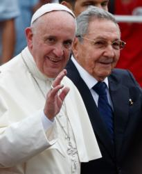 Pope Francis waves as he walks with Cuban President Raul Castro at Jose Marti International Airport in Havana Sept. 19. (CNS photo/Paul Haring)