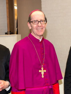 Phoenix Bishop Thomas J. Olmsted, center, is seen with Fathers Kenneth Walker, left, and Joseph Terra, right, in a recent photo. The two priests of the Mater Miseidordiae (Mother of Mercy) Mission. On June 11 the priests were victims of a violent attack. Father Walker died of a gunshot wound. Father Terra June 12 was listed in critical but stable condition. (CNS photo/courtesy PhoenixLatinMass.com) (June 12, 2014) See PRIESTS-ATTACK June 12, 2014.