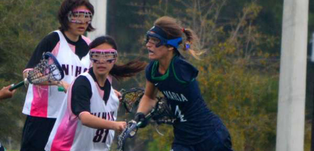 Valeria Tkacik playing lacrosse for Ave Maria University. (Photo courtesy of Sports Up Today)