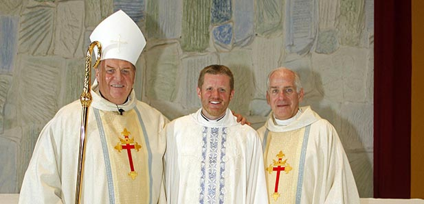 Archbishop Joseph Tobin, C.Ss.R, left, newly ordained Father Robert Jones, SM, and Father Martin Solma, SM, provincial of the Society of Mary, Province of the United States pose for a photo. (Courtesy Photo/Skip Peterson)
