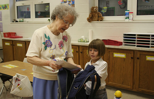 Sister Rose William Herzog chats with a student at St. John the Baptist School in Harrison. (Courtesy Photo)