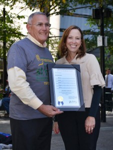 St. Rita Executive Director Gregory Ernst, left, with Cincinnati City Councilwoman Amy Murray and a proclamation naming Oct. 14, 2015, St. Rita School for the Deaf Day in Cincinnati. (CT Photo/John Stegeman)