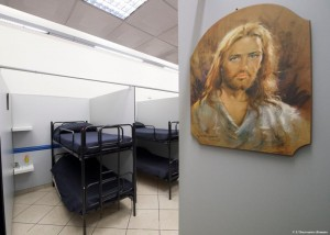 An image of Christ is seen near beds Oct. 8 inside the Gift of Mercy, a shelter for homeless men, just a few hundred yards away from St. Peter's Square. Housed in a Jesuit-owned building, the shelter was created by and is run with funds from the papal almoner, who has taken a variety of initiatives to assist the homeless people in the area surrounding the Vatican. (CNS photo/L'Osservatore Romano, handout)