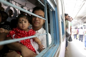 A family travels by train in Kolkata, India, May 25. Pope Francis announced Oct. 22 that he is establishing a new office for laity, family and life, which combines the responsibilities of two pontifical councils. (CNS photo/Piyal Adhikary, EPA)