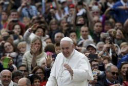 Pope Francis waves as he arrives to lead his weekly audience in St. Peter's Square at the Vatican Sept. 30. (CNS photo/Max Rossi, Reuters)