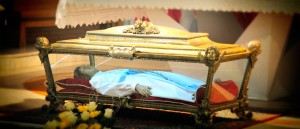 St. Maria's remains are inside a glass-sided casket.  Inside the casket is a wax statue within which repose her skeletal remains. (Courtesy Photo)