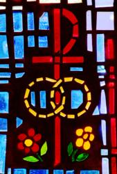 A pair of wedding bands symbolizing the sacrament of marriage is depicted in a stained-glass window at St. Isabel Church in Sanibel, Fla. As Catholics prepare for the world Synod of Bishops on the family in October, a number of church leaders and theologians are discussing ways to reach out to divorced and civilly remarried Catholics. (CNS photo/Gregory A. Shemitz)