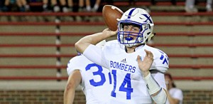 St. Xavier quarterback Sean Clifford looks for a target during a game against Moeller at Nippert Stadium. The Bombers are one of six area Catholic schools still alive this postseason. (CT Photo/E.L. Hubbard)