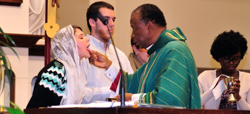 Bishop Edward Braxton of Belleville, Illinois distributes Holy Communion to Megan Earley Nov. 8 at the University of Dayton's Immaculate Conception Chapel. (CT Photo/Jeff Unroe)