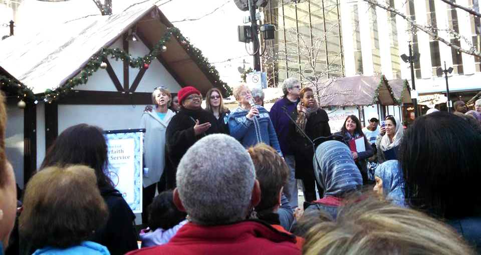 A group of women sing during a women-led interfaith prayer service for peace in downtown Cincinnati on Dec. 16. (Courtesy Photo/Sister Tracy Kemme)