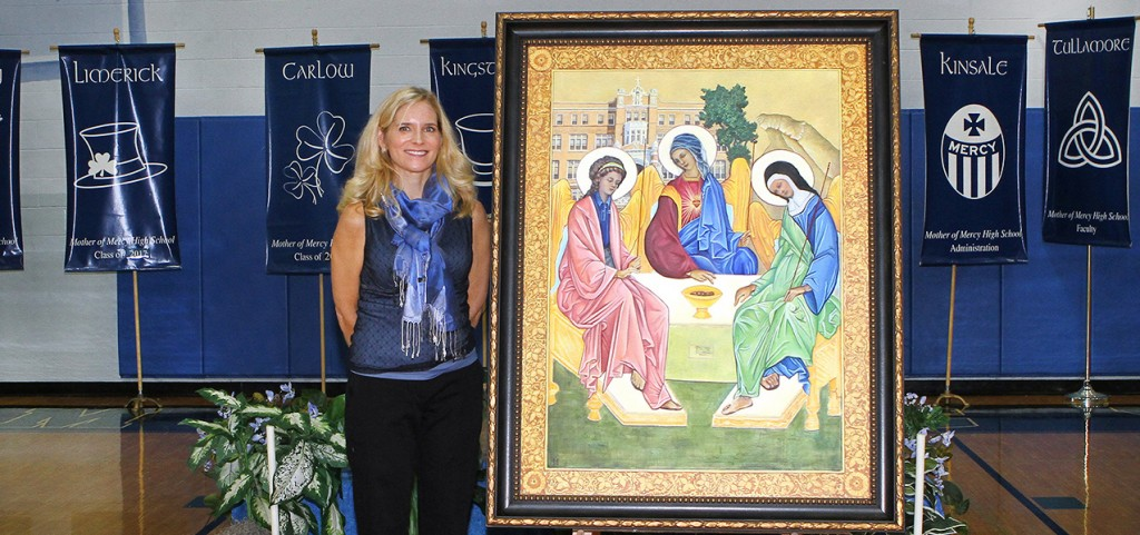 Artist and Mercy alumna Holly Schapker unveils her painting honoring Mother of Mercy's 100 years. (Courtesy Photo)