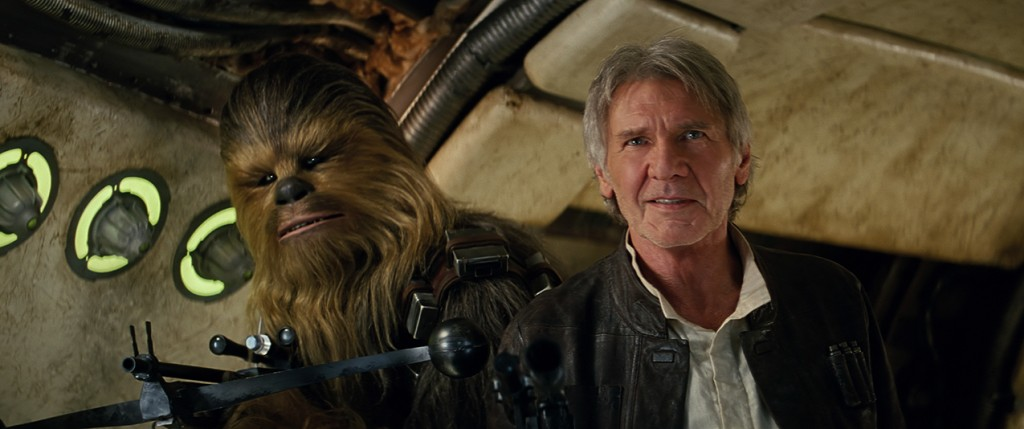 """Chewbacca, played by Peter Mayhew, and Harrison Ford star in a scene from the movie """"Star Wars: The Force Awakens."""" The Catholic News Service classification is A-II -- adults and adolescents. The Motion Picture Association of America rating is PG-13 -- parents strongly cautioned. Some material may be inappropriate for children under 13. (CNS photo/Disney)"""