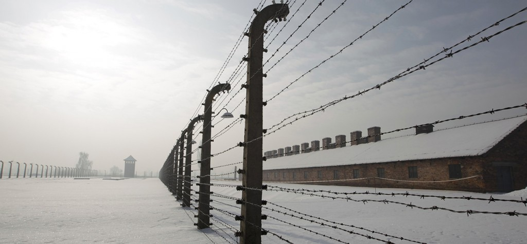 Barbed wire fences are pictured in a snowy scene at the former Auschwitz-Birkenau death camp in Oswiecim, Poland, Jan. 27, 2010. (CNS photo/Peter Andrews, Reuters)