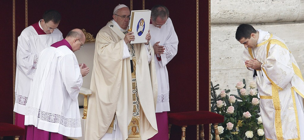 Pope Francis raises the Book of the Gospels as he celebrates the opening Mass of the Holy Year of Mercy in St. Peter's Square at the Vatican Dec. 8. (CNS photo/Paul Haring)