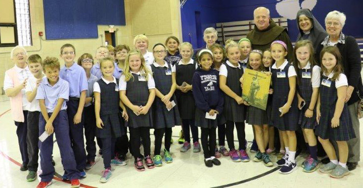 Students at Our Lady of Lourdes enjoyed visiting with priests and religious from various backgrounds as part of Vocations Day. (Courtesy Photo)
