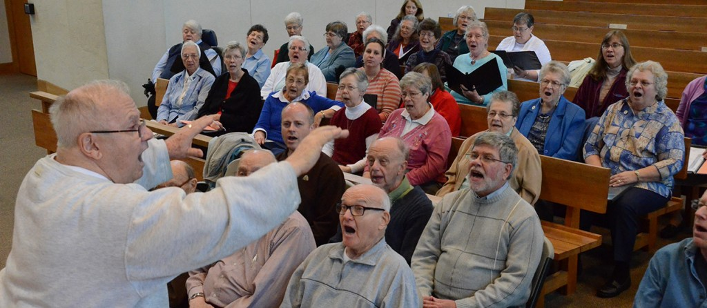"""Franciscan Father Fred Link directs women and men religious during a rehearsal for """"Wake up the World: A Concert Celebrating the Year of Consecrated Life,"""" scheduled for Jan. 17, 3 p.m. at the Cathedral of St. Peter in Chains. (Courtesy Photo)"""