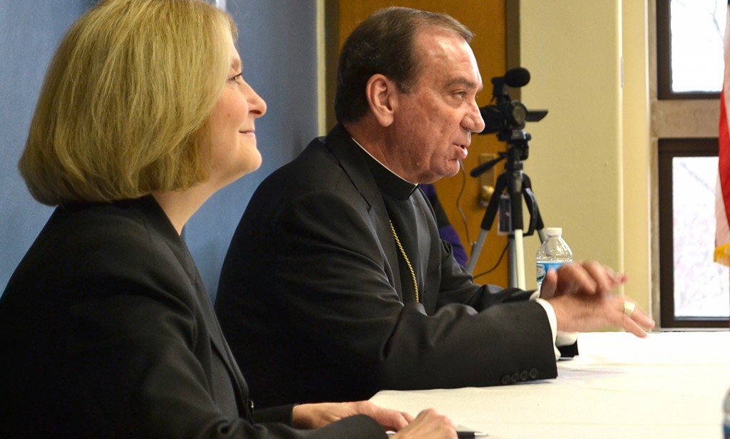 Archbishop of Cincinnati Dennis M. Schnurr, right, answered questions from high school students around the Archdiocese of Cincinnati on Monday via teleconference as part of Catholic Schools Week. This year Lehman Catholic High School in Sidney was host to the broadcast. (CT Photo/John Stegeman)