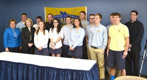 Archbishop Dennis M. Schnurr poses for a photo with Lehman Catholic High School students after his Catholic Schools Week teleconference. (CT Photo/John Stegeman)