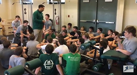 McNicholas high school football players listen to head coach Mike Orlando after completing the SportsLeader Stations of the Cross workout. (Screen shot)