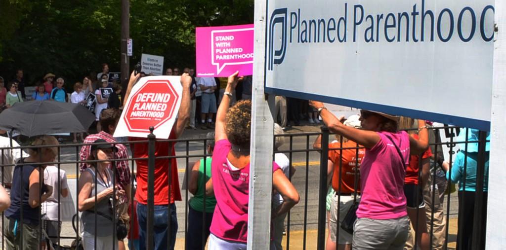 Pro-life and pro-life demonstrators hold signs during a July 29, 2015 #WomenBetrayed rally. (CT Photo/John Stegeman)