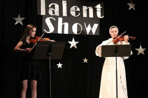 St. Gertrude eighth grader Olivia DeStefano and Junior High teacher Sister Veronica Marie, O.P. perform in a Catholic Schools Week Talent Show.