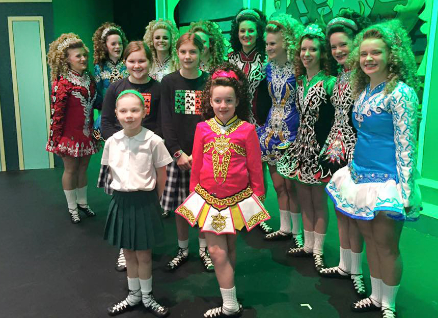 A group from the Erickson Academy of Irish Dance smiles for a photo before performing at Summit Country Day school on March 17, St. Patrick's Day. (Courtesy Photo)