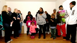 Ebony Bureau gives thanks during the Habitat for Humanity Pope Francis House Dedication Ceremony in Millvale Saturday, Jan. 23, 2016. Bureau, her children, Robert, 7, and Keiasa, 2, and her boyfriend, Robert Davis, III, will live in the house. (CT Photo/E.L. Hubbard)