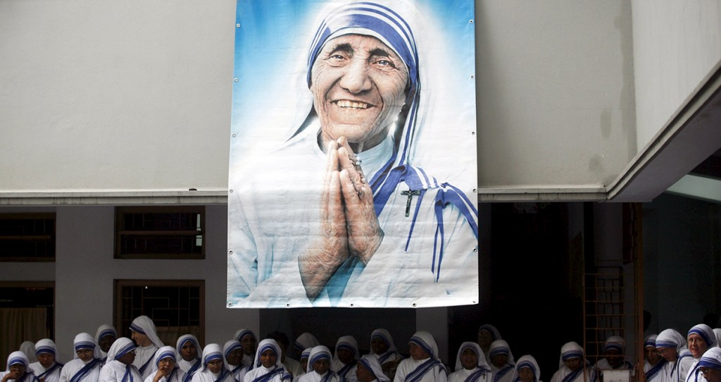 A poster of Blessed Teresa of Kolkata and Missionaries of Charity are seen in Kolkata, India, in this Sept. 5, 2007, file photo. Pope Francis will declare her a saint at the Vatican Sept. 4, the conclusion of the Year of Mercy jubilee for those engaged in works of mercy. (CNS photo/Jayanta Shaw, Reuters) S