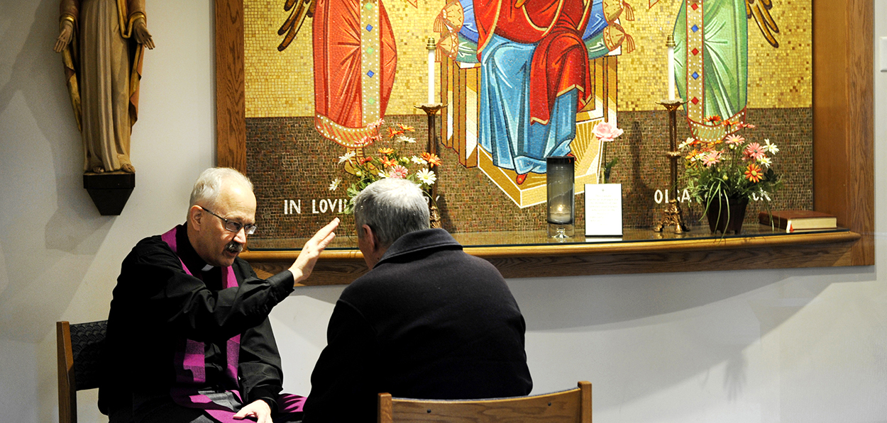 A priest hears a confession in 2013 at Christ the King Church in Irondequoit, N.Y. (CNS photo/Mike Crupi, Catholic Courier)