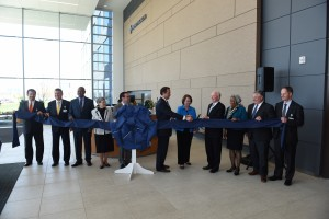Various dignitaries, including Cincinnati Mayor John Cranley, participated in a ribbon cutting ceremony at Mercy Health's new home office. (Courtesy Photo)